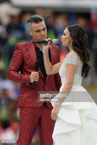 Robbie Williams and Aida Garifullina perform during the opening ceremony prior to the 2018 FIFA World Cup Russia Group A match between Russia and...