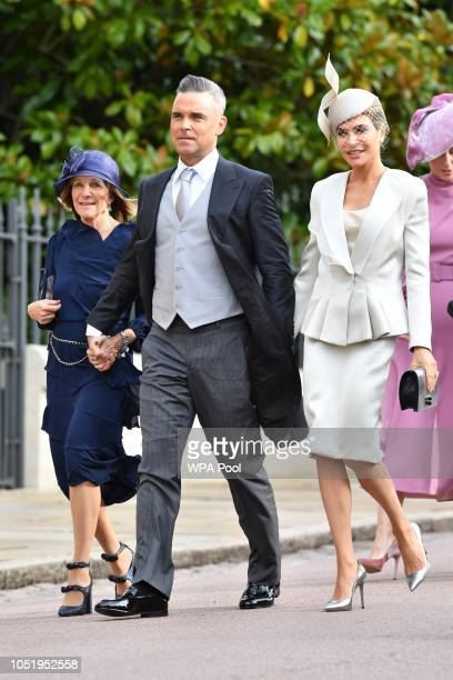 Robbie Williams and Ayda Field attend the wedding of Princess Eugenie of York to Jack Brooksbank at St George's Chapel on October 12 2018 in Windsor...