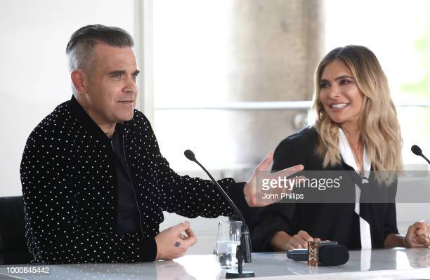 Robbie Williams and Ayda Field speak during The X Factor 2018 launch at Somerset House on July 17 2018 in London England