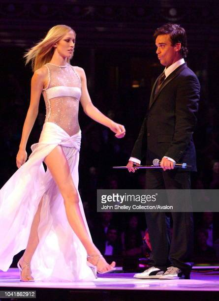 Robbie Williams And Donatella Versace Onstage During The Fashion Rocks Ball In Aid Of The The Princes Trust Royal Albert Hall London 15 October 2003...