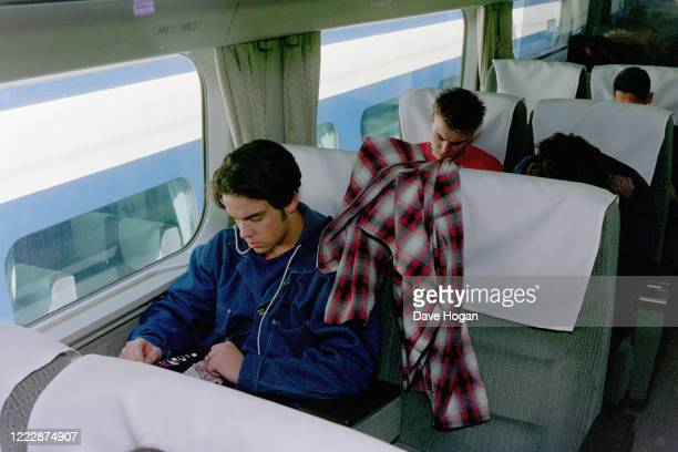 Robbie Williams and Gary Barlow of Take That travel on the bullet train in Tokyo, March 1993