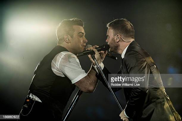 Robbie Williams and Gary Barlow perform on the second night of Robbie Williams tour at 02 Arena on November 23 2012 in London England