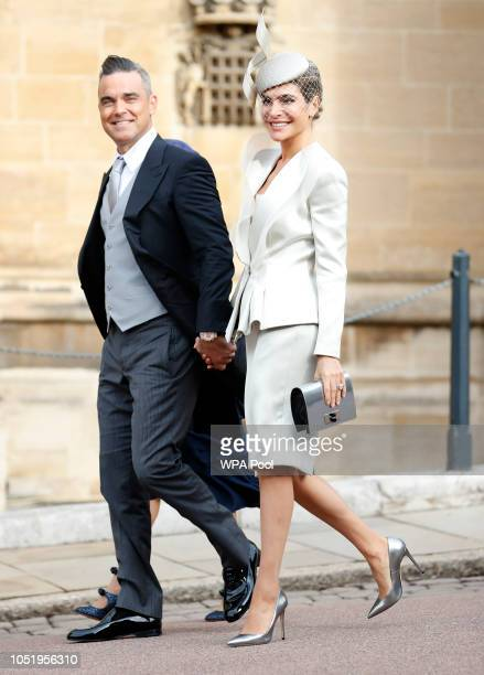 Robbie Williams and his wife Ayda Field arrive ahead of the wedding of Princess Eugenie of York and Mr Jack Brooksbank at St George's Chapel on...