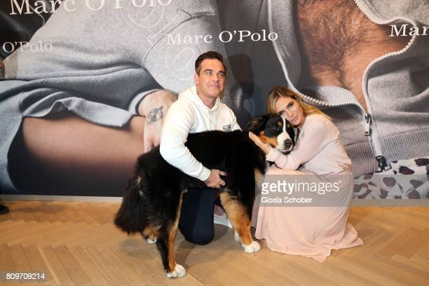 Robbie Williams and his wife Ayda Williams and their dog 'Showbiz' during the launch of the Marc O'Polo 50th anniversary special edition sweatshirt...