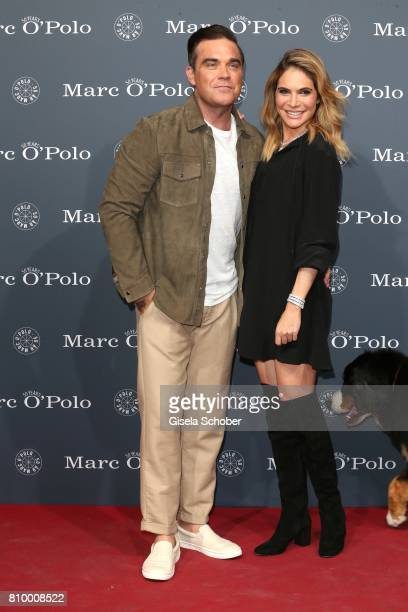 Robbie Williams and his wife Ayda Williams during the 50th anniversary celebration of Marc O'Polo at its headquarters on July 6 2017 in...