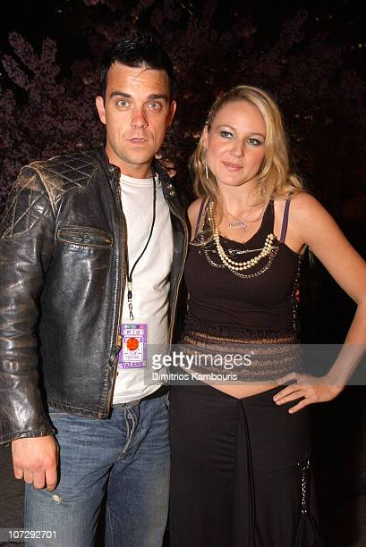 Robbie Williams and Jewel during MTV and VH1 Present '100% NYC A Concert Celebrating The Tribeca Film Festival' Backstage at Battery Park City in New...