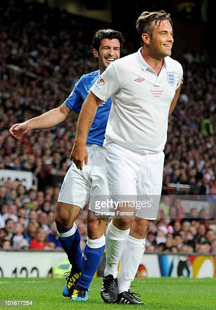 Robbie Williams and Luis Figo participates in Soccer Aid in aid of UNICEF at Old Trafford on June 6 2010 in Manchester England