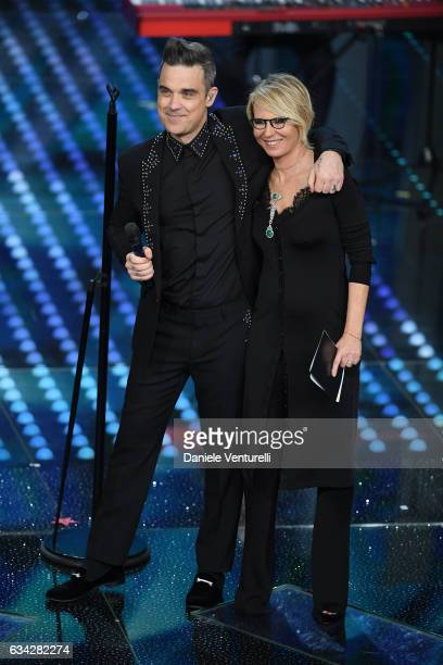 Robbie Williams and Maria De Filippi attend the second night of the 67th Sanremo Festival 2017 at Teatro Ariston on February 8 2017 in Sanremo Italy