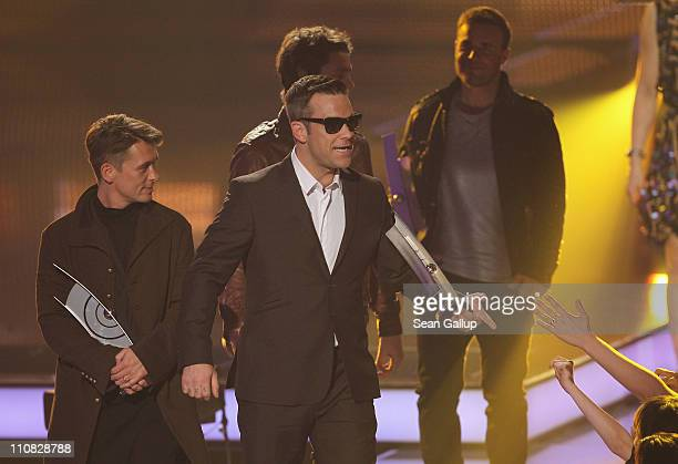 Robbie Williams and other members of the UK band Take That walk offstage after receiving their International Band Rock/Pop Award at the Echo Awards...