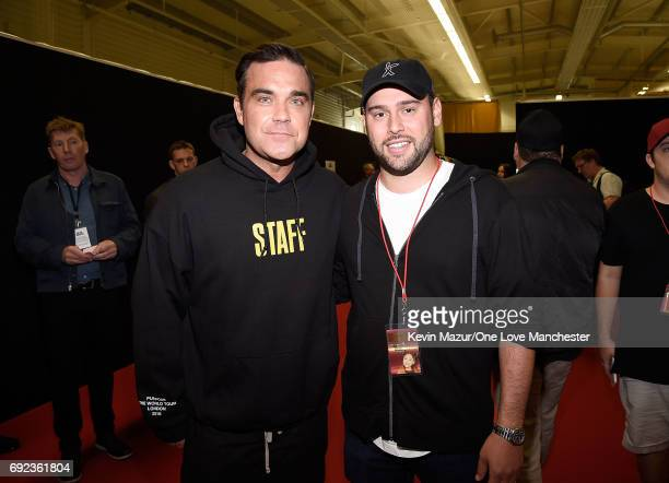 Robbie Williams and Scooter Braun backstage during the One Love Manchester Benefit Concert at Old Trafford Cricket Ground on June 4 2017 in...