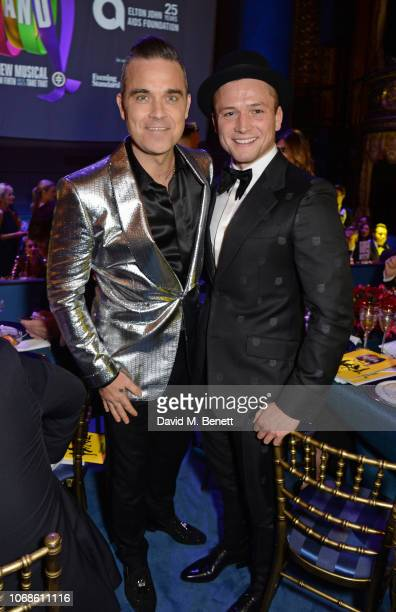 "Robbie Williams and Taron Egerton attend the Opening Night Gala of ""The Band"" to benefit the Elton John AIDS Foundation supported by The Evening..."