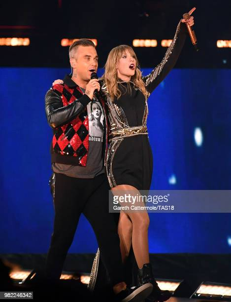 Robbie Williams and Taylor Swift perform on stage during the reputation Stadium Tour at Wembley Stadium on June 23 2018 in London England