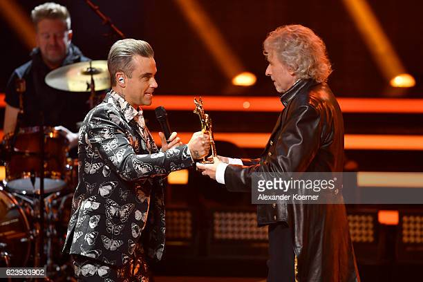 Robbie Williams and Thomas Gottschalk are seen on stage during the Bambi Awards 2016 show at Stage Theater on November 17 2016 in Berlin Germany