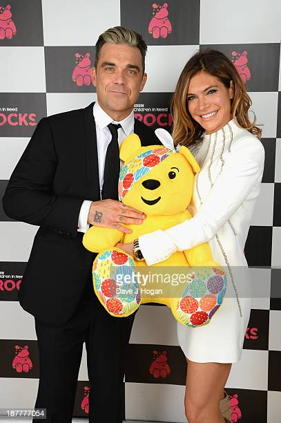 Robbie Williams and wfie Ayda Field pose backstage during the 'BBC Children In Need Rocks' at Eventim on November 12 2013 in London England BBC...