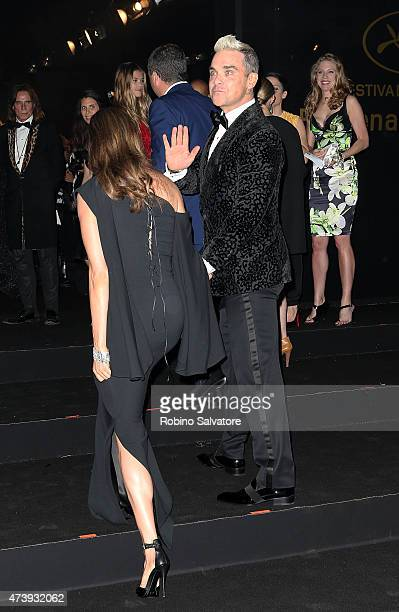 CANNES FRANCE MAY 18 Robbie Williams and wife sighted at the Chopard GOLD party in Cannes 2015 May 18 in Cannes France