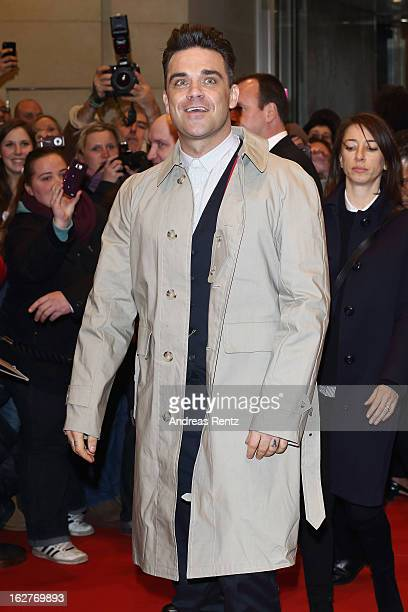Robbie Williams arrives to promote his fashionlabel 'Farrell' at KaDeWe department store on February 26 2013 in Berlin Germany