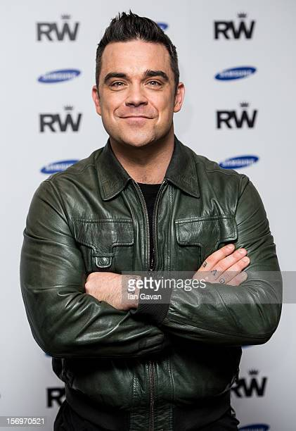 Robbie Williams attends a photocall to announce a forthcoming stadium tour for Summer 2013 in conjunction with Samsung at Soho Hotel on November 26...