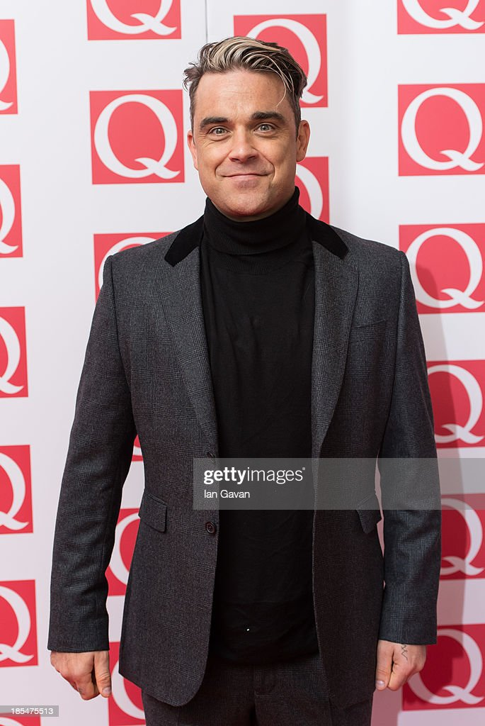 Robbie Williams attends The Q Awards at The Grosvenor House Hotel on October 21, 2013 in London, England.