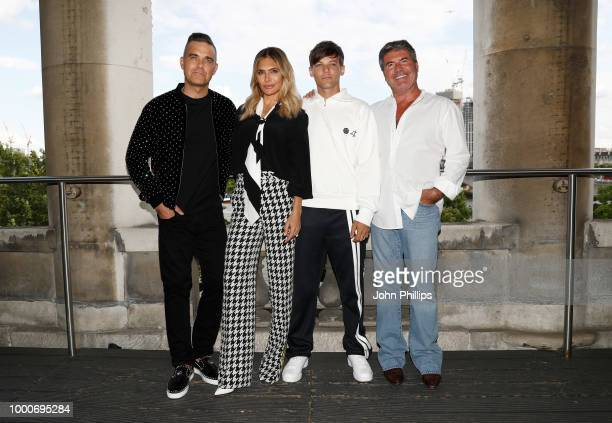Robbie Williams Ayda Field Louis Tomlinson and Simon Cowell pose during The X Factor 2018 launch at Somerset House on July 17 2018 in London England