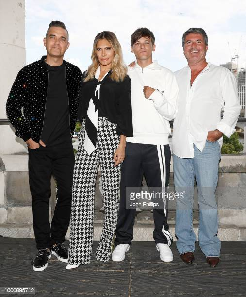 Robbie Williams Ayda Field host Dermot O'Leary Louis Tomlinson and Simon Cowell pose during The X Factor 2018 launch at Somerset House on July 17...
