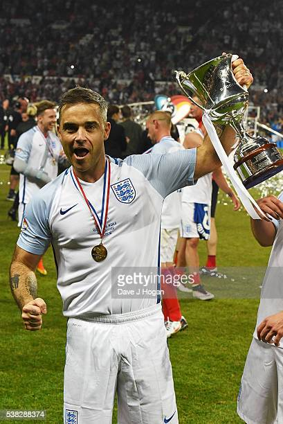 Robbie Williams celebrates winning Soccer Aid at Old Trafford on June 5 2016 in Manchester England