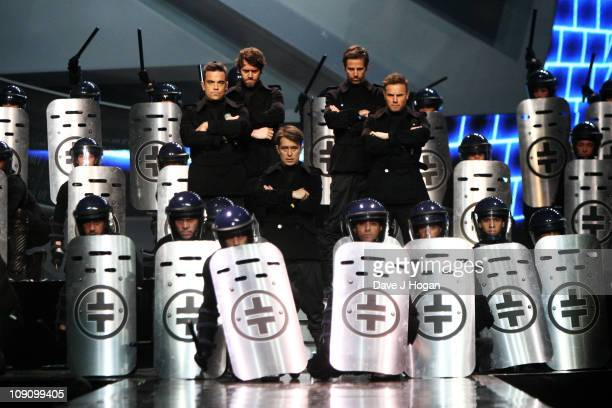 Robbie Williams, Howard Donald, Mark Owen, Jason Orange and Gary Barlow of Take That perform onstage in rehearsal for The Brit Awards 2011 held at...