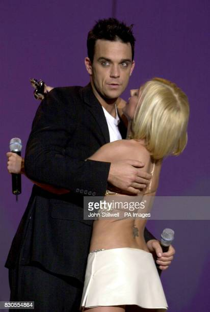 Robbie Williams hugs Geri Halliwell after winning Best British Male during The Brit Awards 2001 hosted by SMTV presenters Ant And Dec at Earls Court...