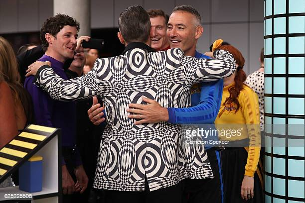 Robbie Williams hugs members of The Wiggles on arrival for the 30th Annual ARIA Awards 2016 at The Star on November 23 2016 in Sydney Australia