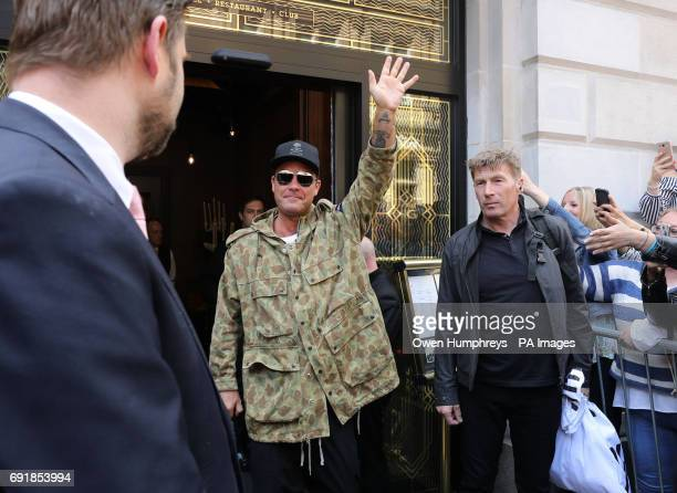 Robbie Williams leaving his hotel in Manchester the day after his concert at the Etihad Stadium where he became emotional on stage as he paid tribute...