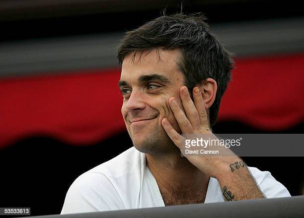 Robbie Williams of England watches the golf during the monday fourball matches on the final day of All-Star Cup on the Roman Road Course at The...