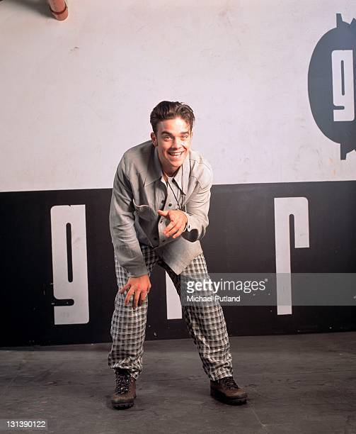 Robbie Williams of Take That studio portrait London 1991