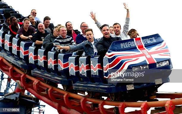 Robbie Williams Olly Murs and Jonathan Wilkes enjoy the Rides at Blackpool Pleasure Beach at Blackpool Pleasure Beach on June 20 2013 in Blackpool...