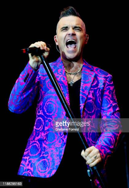 Robbie Williams performs at Hits Radio Live 2019 at Manchester Arena on November 17 2019 in Manchester England