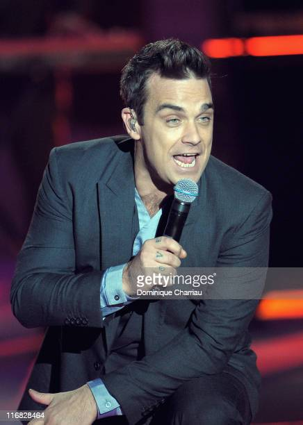 Robbie Williams performs at the 2010 Miss France Beauty pageant at the Palais Nikaia on December 5 2009 in Nice France