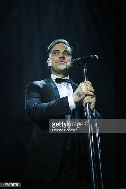 Robbie Williams performs at the 'Under 1 Roof' concert in aid of Kids Company at Hammersmith Apollo on December 19 2013 in London England