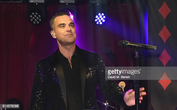 Robbie Williams performs at the Unicef UK Halloween Ball raising vital funds to support Unicef's lifesaving work for Syrian children in danger at One...