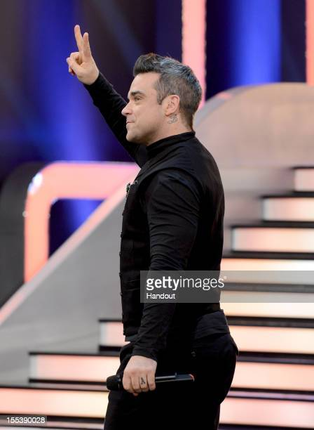 Robbie Williams performs during the 'Wetten dass..?' show on November 3, 2012 in Bremen, Germany.