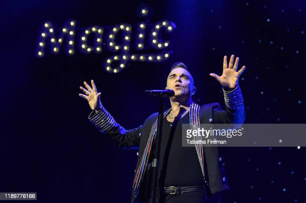 Robbie Williams performs live on stage during Magic Radio's Magic of Christmas with 'Last Christmas' at London Palladium on November 24 2019 in...