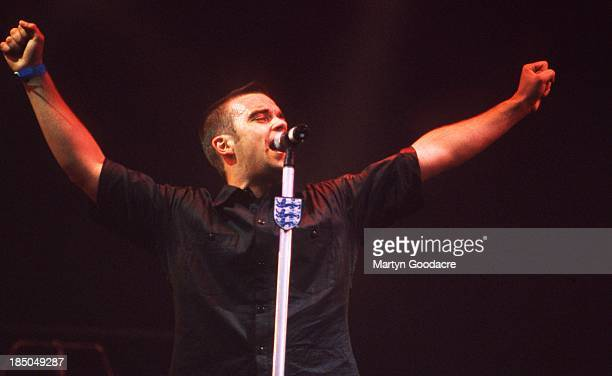 Robbie Williams performs on stage at Glastonbury Festival United Kingdom 1998