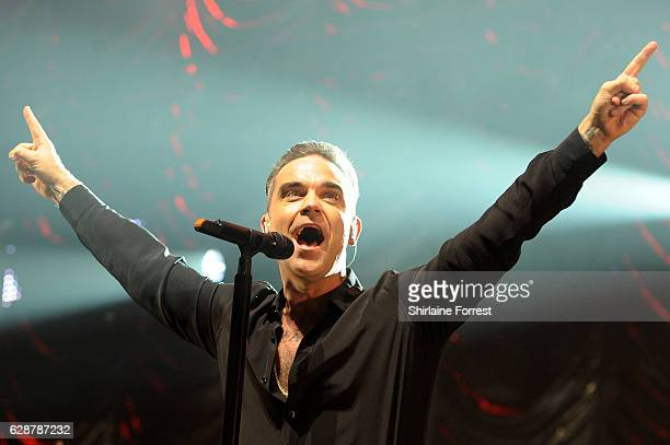 Robbie Williams performs on stage at Key 103 Christmas Live at Manchester Arena on December 9 2016 in Manchester England