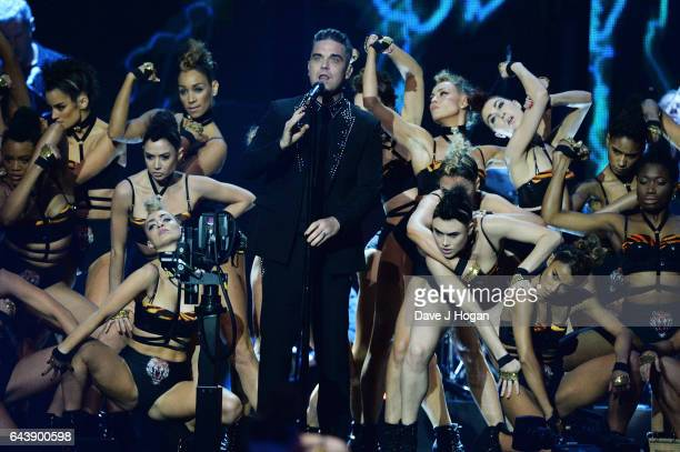 ONLY Robbie Williams performs on stage at The BRIT Awards 2017 at The O2 Arena on February 22 2017 in London England