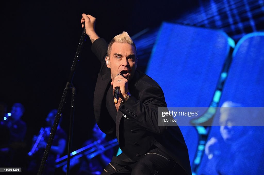 Robbie Williams performs onstage during the Second Day of the 10th Anniversary on the Throne Celebrations on July 12, 2015 in Monaco, Monaco.