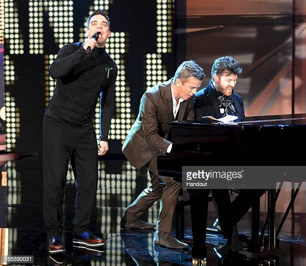Robbie Williams performs with Markus Lanz during the 'Wetten dass..?' show on November 3, 2012 in Bremen, Germany.
