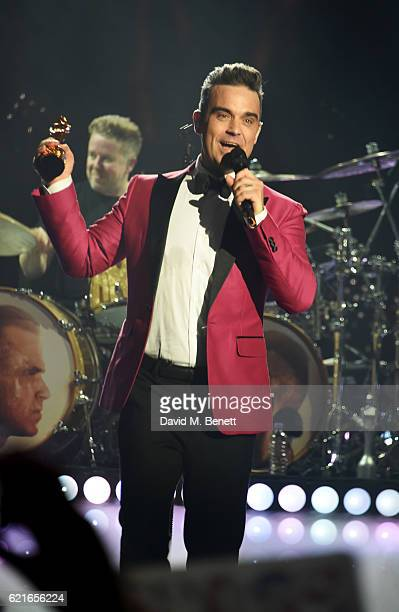 Robbie Williams receives the BRITs Icon Award at a special gig presented by Cafe Royal at the Troxy on November 7 2016 in London England