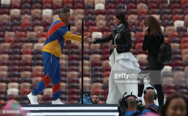 Robbie Williams shakes hands with Russian soprano Aida Garifullina during the rehearsals for the Opening Ceremony of the 2018 FIFA World Cup Russia...