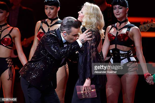 Robbie Williams smells moderator Barbara Schoeneberger on stage during the Bambi Awards 2016 show at Stage Theater on November 17, 2016 in Berlin,...