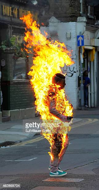 Robbie Williams' stuntman is seen during filming of a stunt scene his music video 'Candy' on August 18 2012 in London United Kingdom