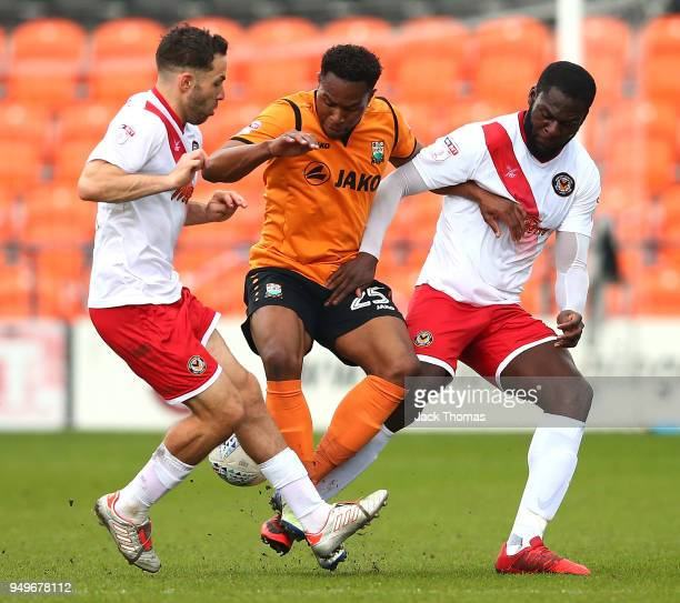 Robbie Willmott Frank Nouble of Newport County AFC and JeanLouis Akpa Akpro Barnet FC compete for the ball during the Sky Bet League Two match...