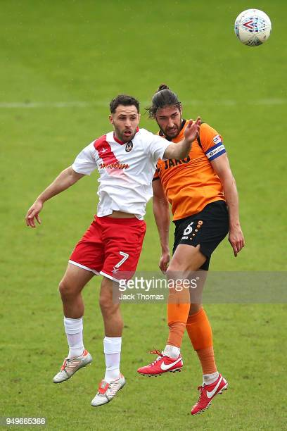Robbie Willmott of Newport County AFC and Dan Sweeney of Barnet FC in action during the Sky Bet League Two match between Barnet FC and Newport County...