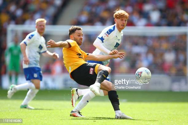 Robbie Willmott of Newport County battles for possession with Ben Pringle of Tranmere Rovers during the Sky Bet League Two Playoff Final match...